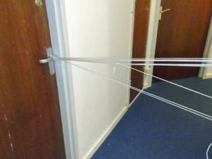 dorm-room-prank-doors-tied-together